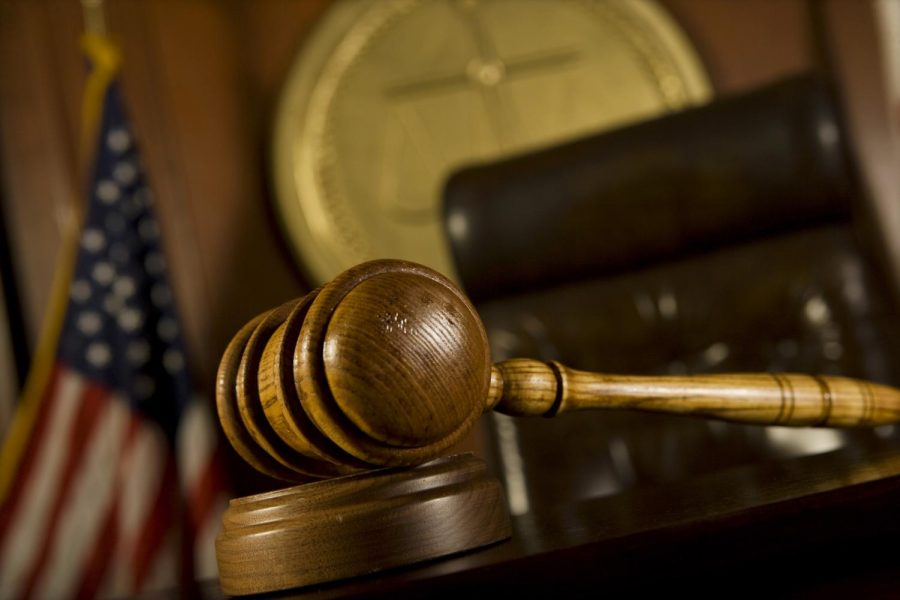 A closeup of a gavel in court.