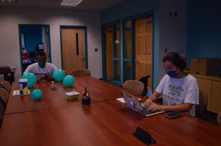 Students Boyce Rucker and Lauren Wessell working in the Student Media Center.
