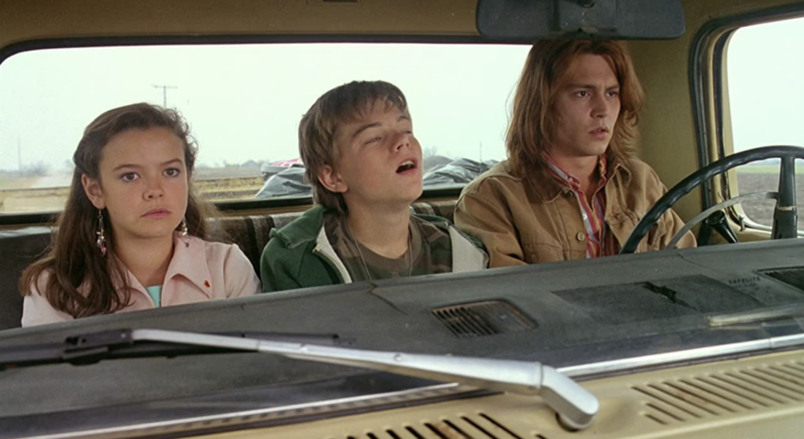 """Mary Kate Schellhardt, Leonardo DiCaprio, and Johnny Depp in """"What's Eating Gilbert Grape"""" (1993)."""